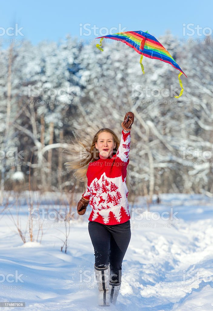 Beautiful young woman with kite stock photo