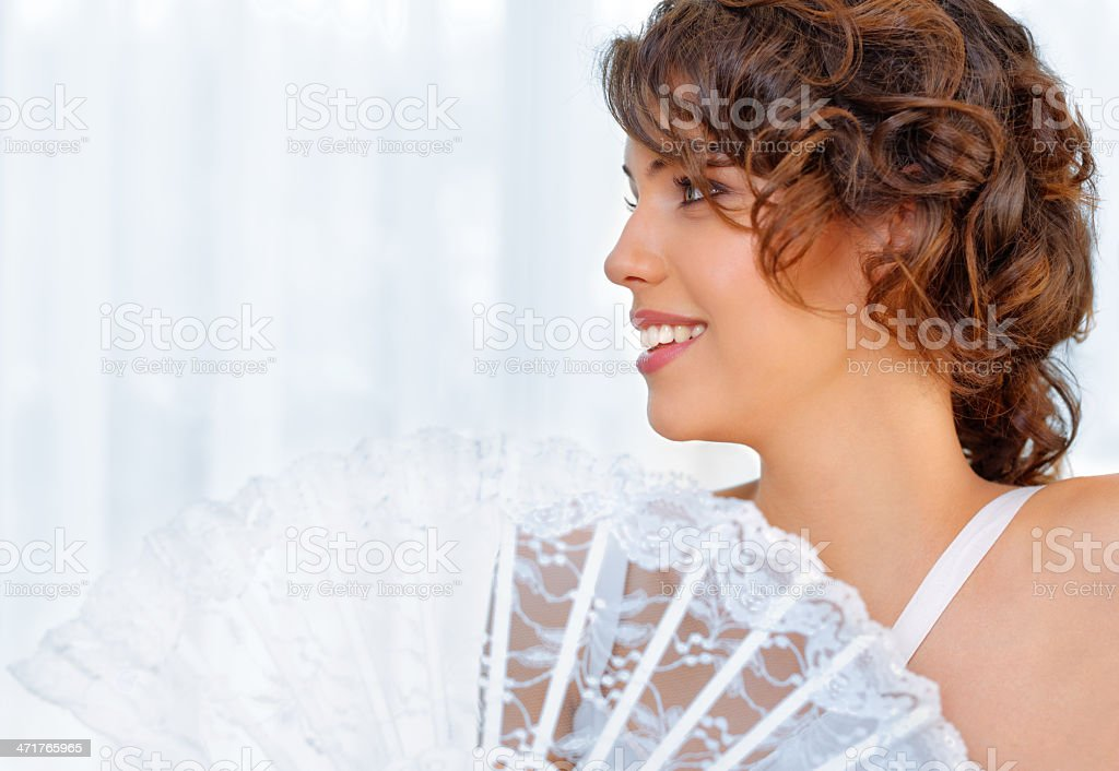 Beautiful young woman with lace fan royalty-free stock photo