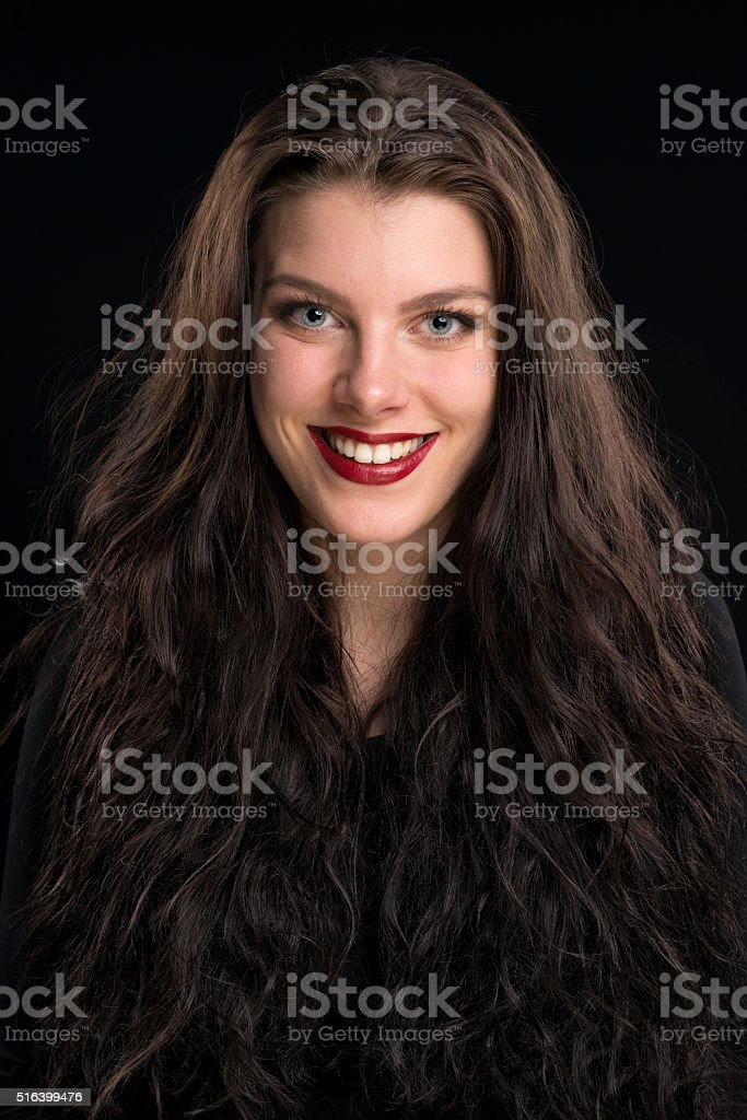 beautiful young woman with long brown hair smiling stock photo