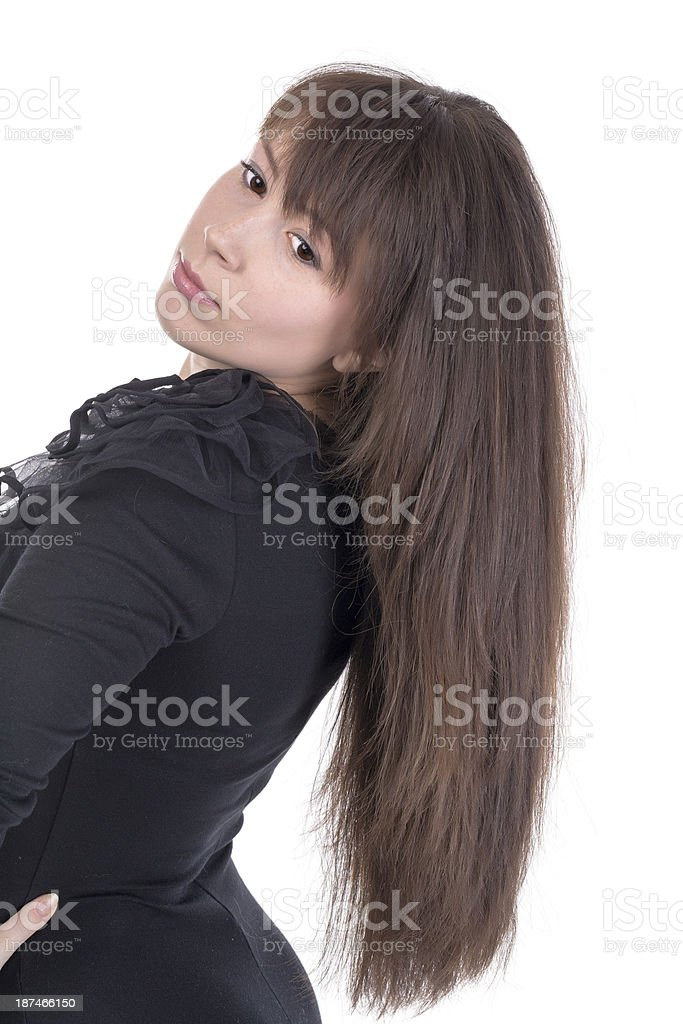 Beautiful young woman with long brunette hair royalty-free stock photo