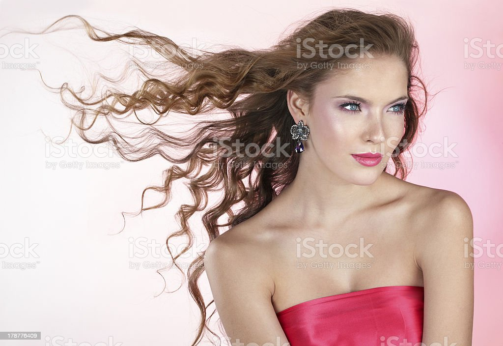 Beautiful young woman with long curly hair royalty-free stock photo