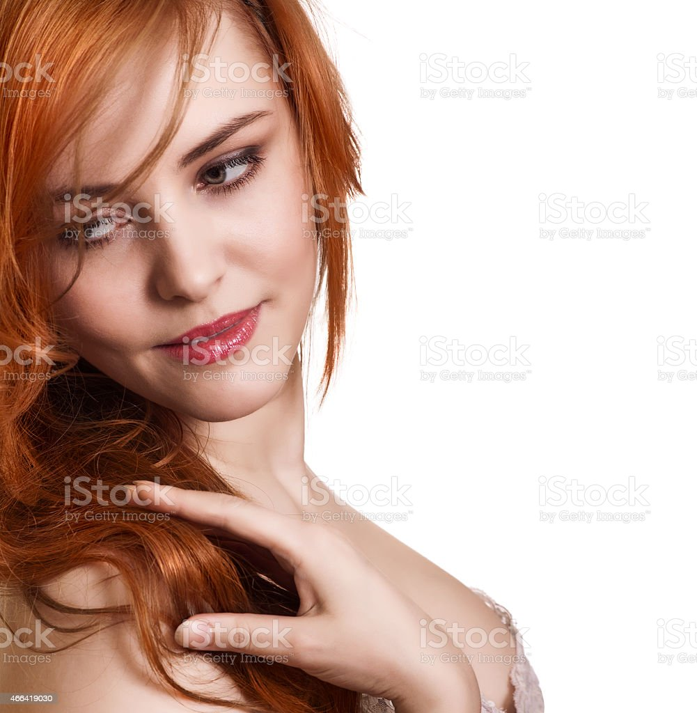 A beautiful young woman with long red hair stock photo