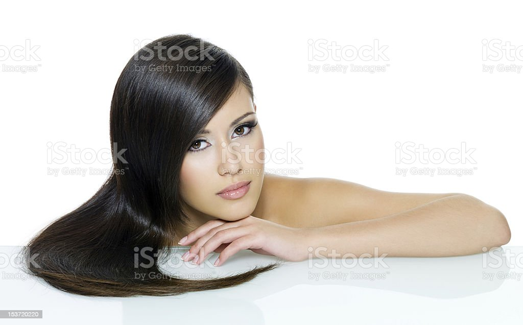 Beautiful young woman with long straight brown hair royalty-free stock photo