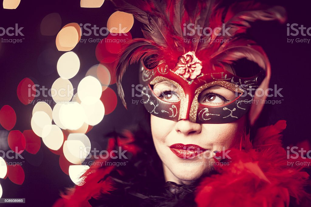 Beautiful young woman with masquerade mask stock photo
