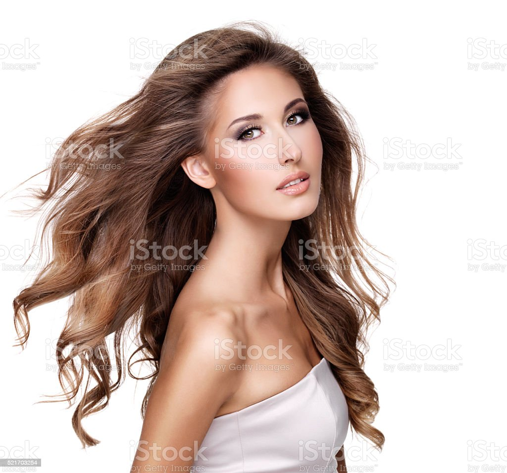 beautiful young woman with moving long wavy hair stock photo