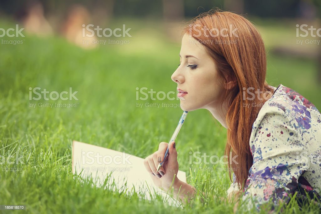 beautiful young woman with note at outdoor royalty-free stock photo