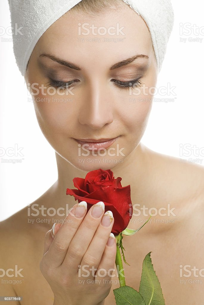 Beautiful young woman with red rose royalty-free stock photo