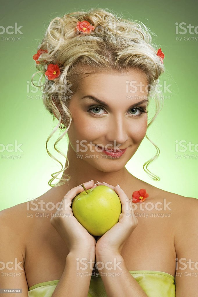 Beautiful young woman with ripe green apple royalty-free stock photo