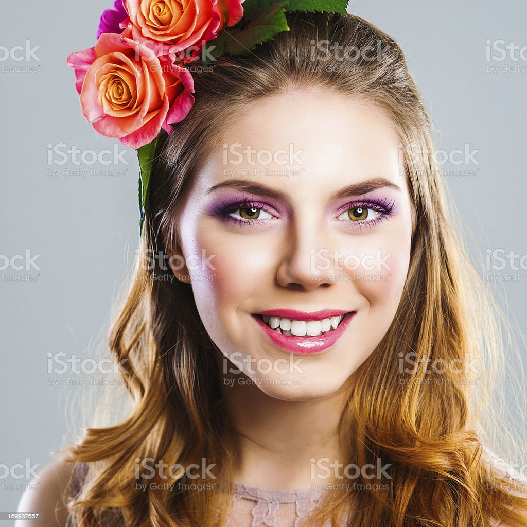 Beautiful young woman with roses in her hair royalty-free stock photo
