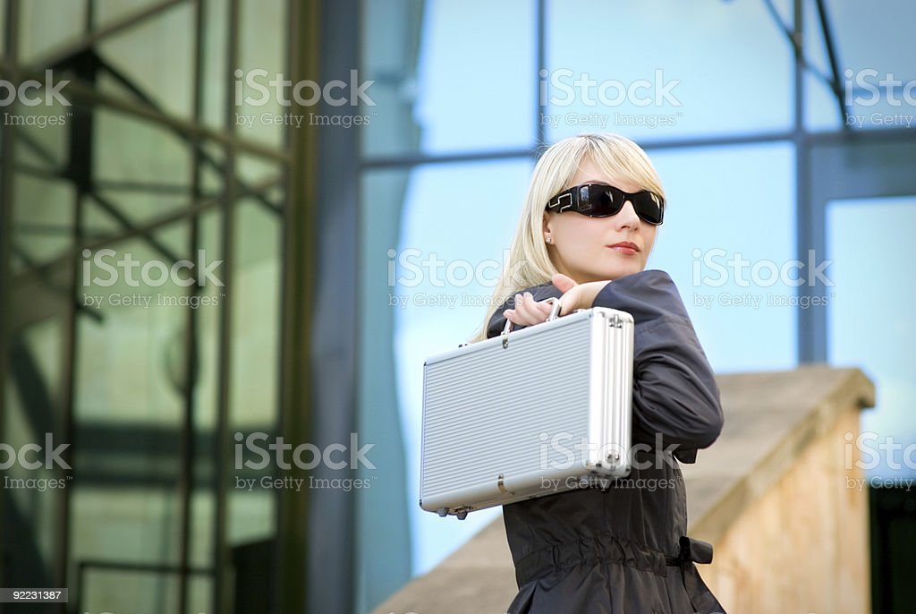 Beautiful young woman with silver case royalty-free stock photo