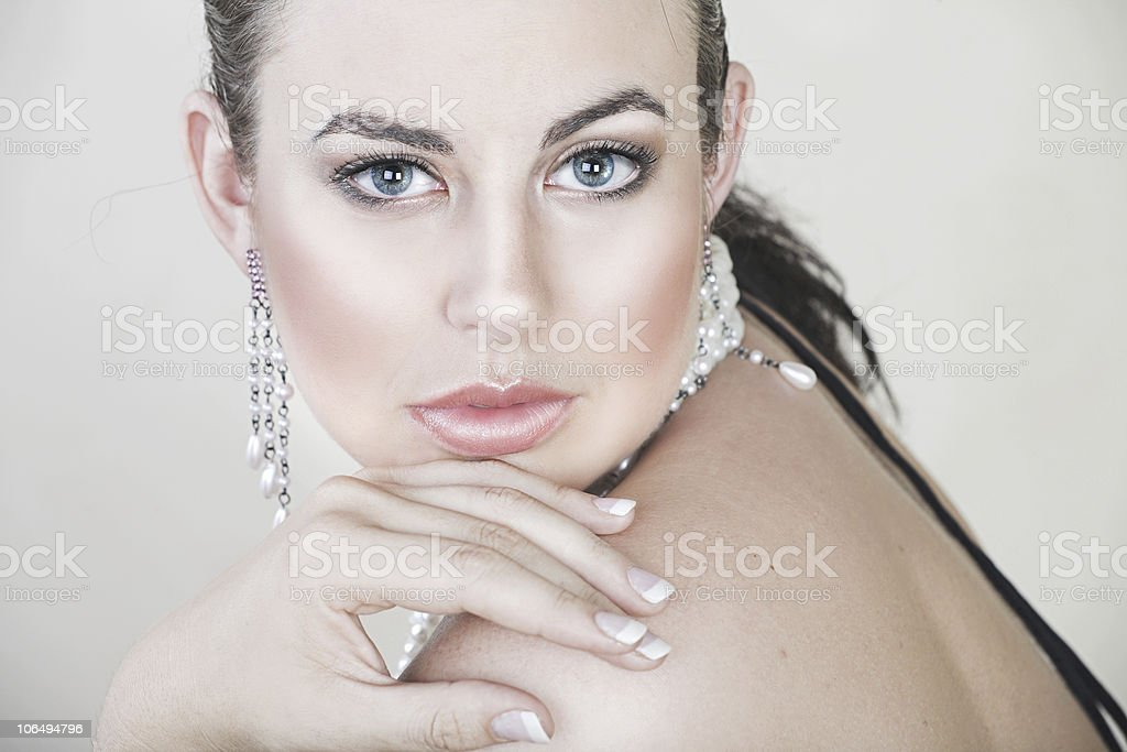 Beautiful young woman with silver jewellery royalty-free stock photo