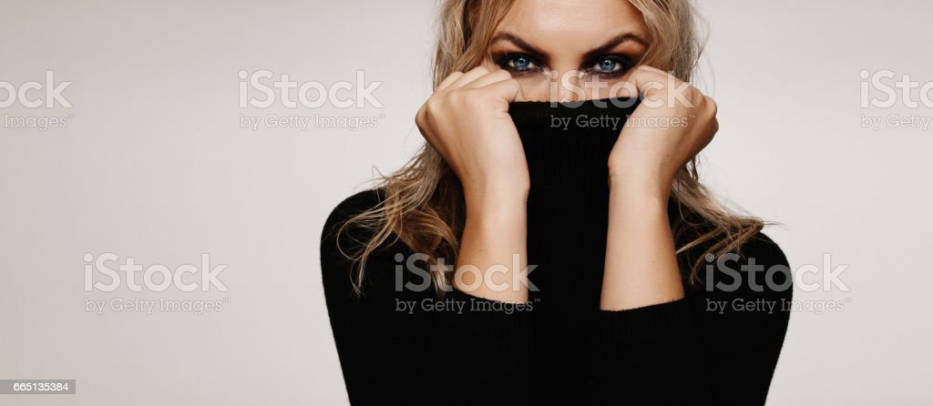 Beautiful young woman with smokey look stock photo