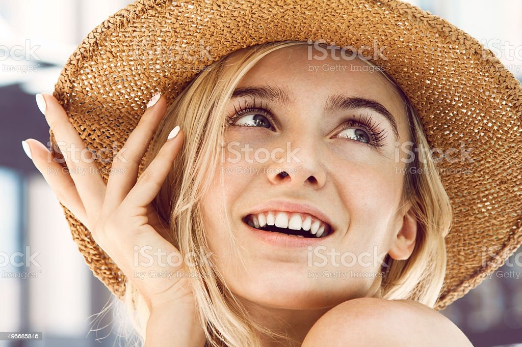 Beautiful young woman with strawy hat stock photo