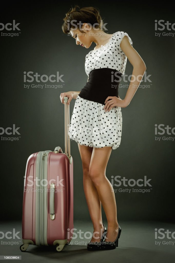 Beautiful Young Woman with suitcase ready for travel royalty-free stock photo