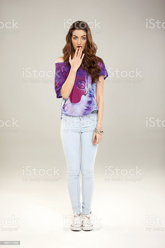 Beautiful young woman with surprised expression royalty-free stock photo