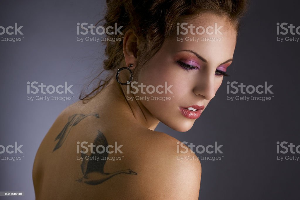 Beautiful Young Woman with Tattoos and Make Up, Copy Space royalty-free stock photo