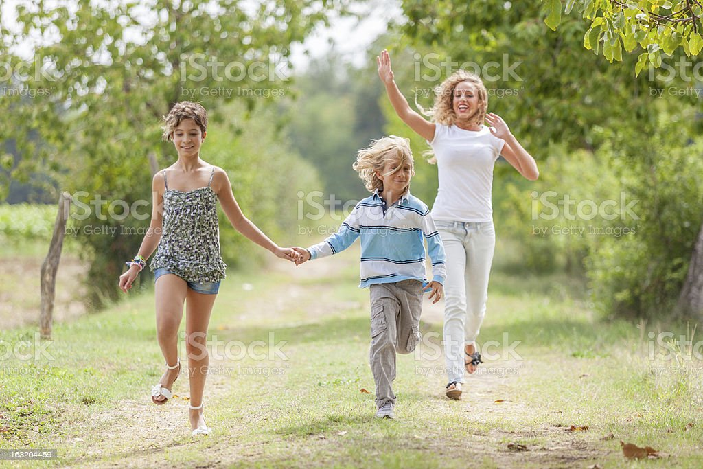 Beautiful Young Woman with Two Children Outside royalty-free stock photo