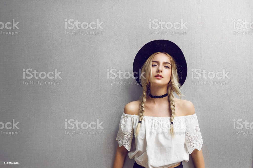 Beautiful young woman with two pigtails stock photo