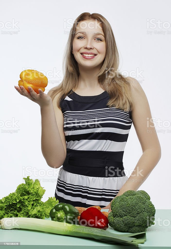 Beautiful young woman with vegetables royalty-free stock photo