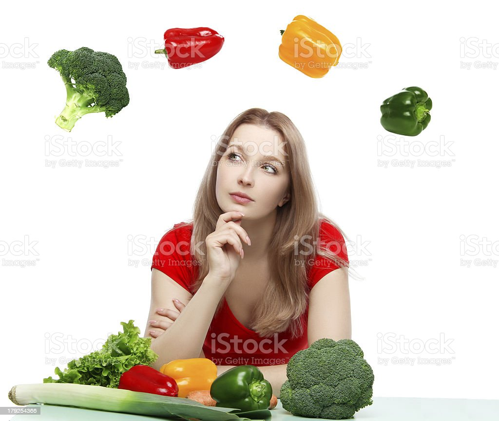 Beautiful young woman with vegetables stock photo