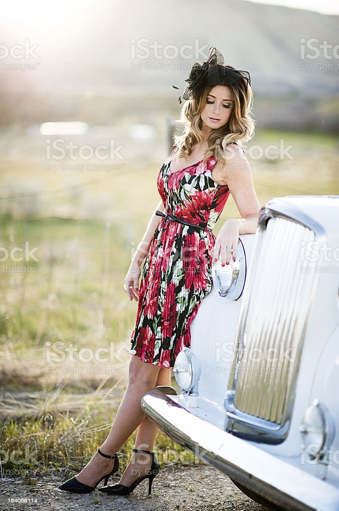 Beautiful young woman with vintage car stock photo