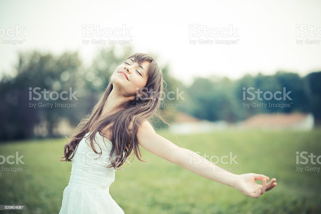 beautiful young woman with white dress stock photo