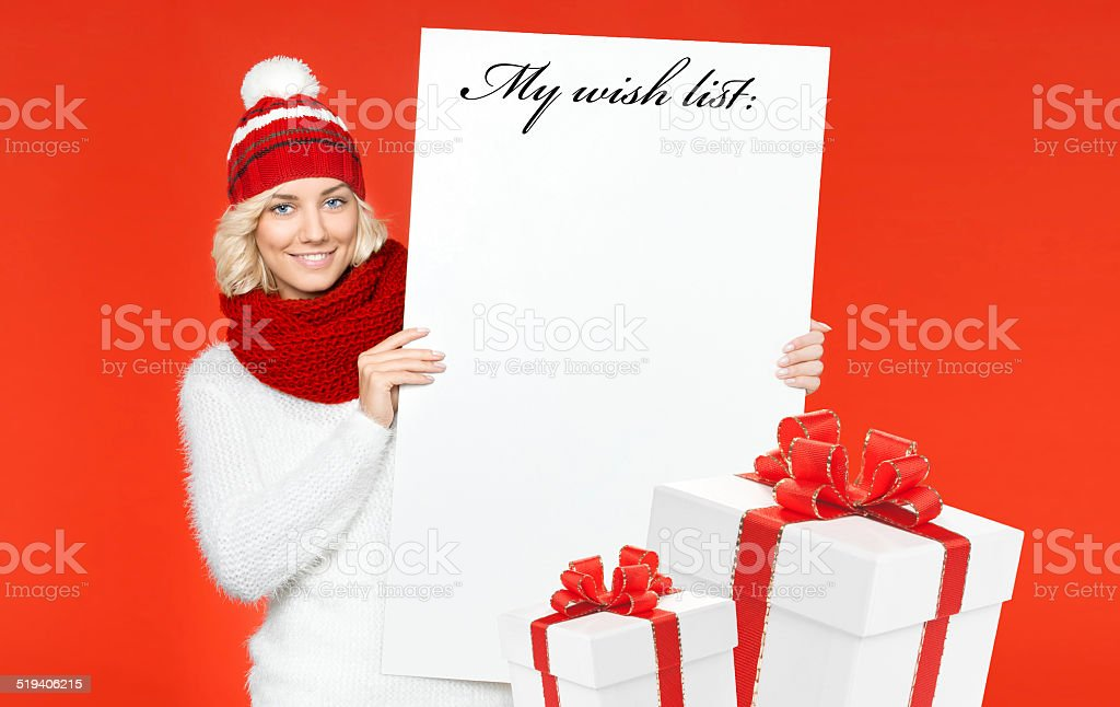 Beautiful young woman with wish list stock photo
