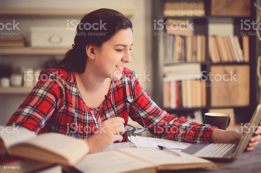 beautiful young woman working at home stock photo