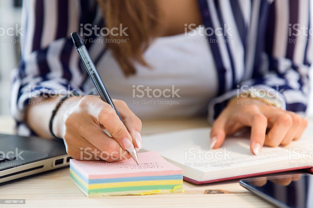 Beautiful young woman working in the office. stock photo