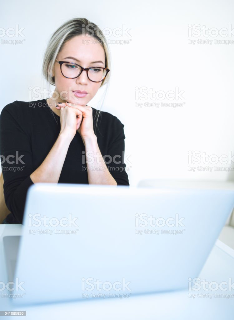 Beautiful young woman working with laptop stock photo