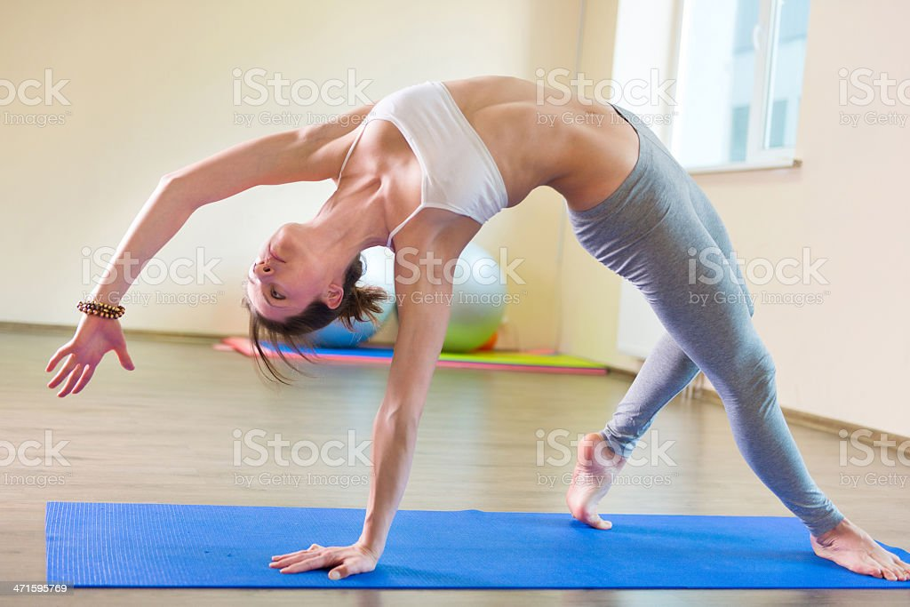 Beautiful young woman yoga workout royalty-free stock photo