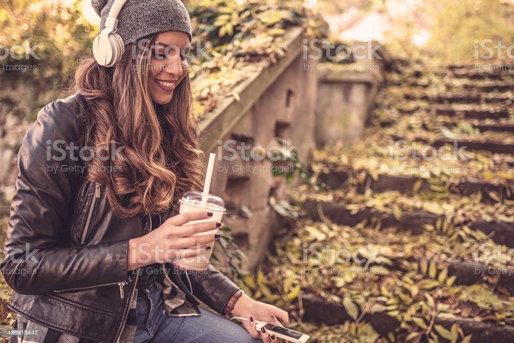 Beautiful young womanenjoy in music outdoors stock photo
