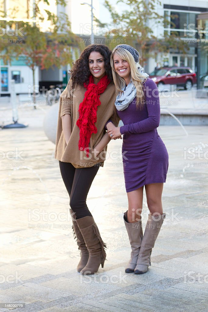 Beautiful young women as friends in park. royalty-free stock photo