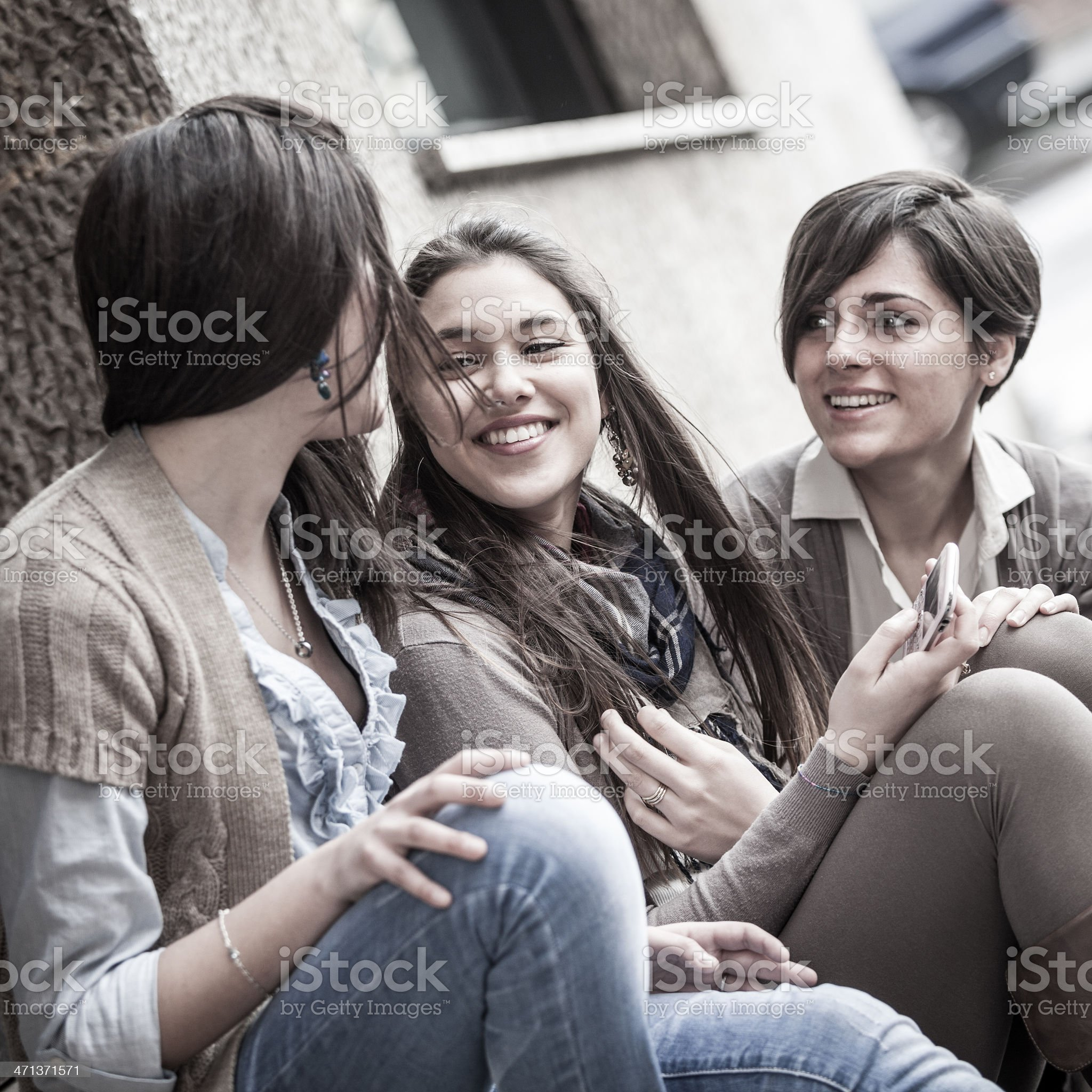 Beautiful young women chatting together royalty-free stock photo