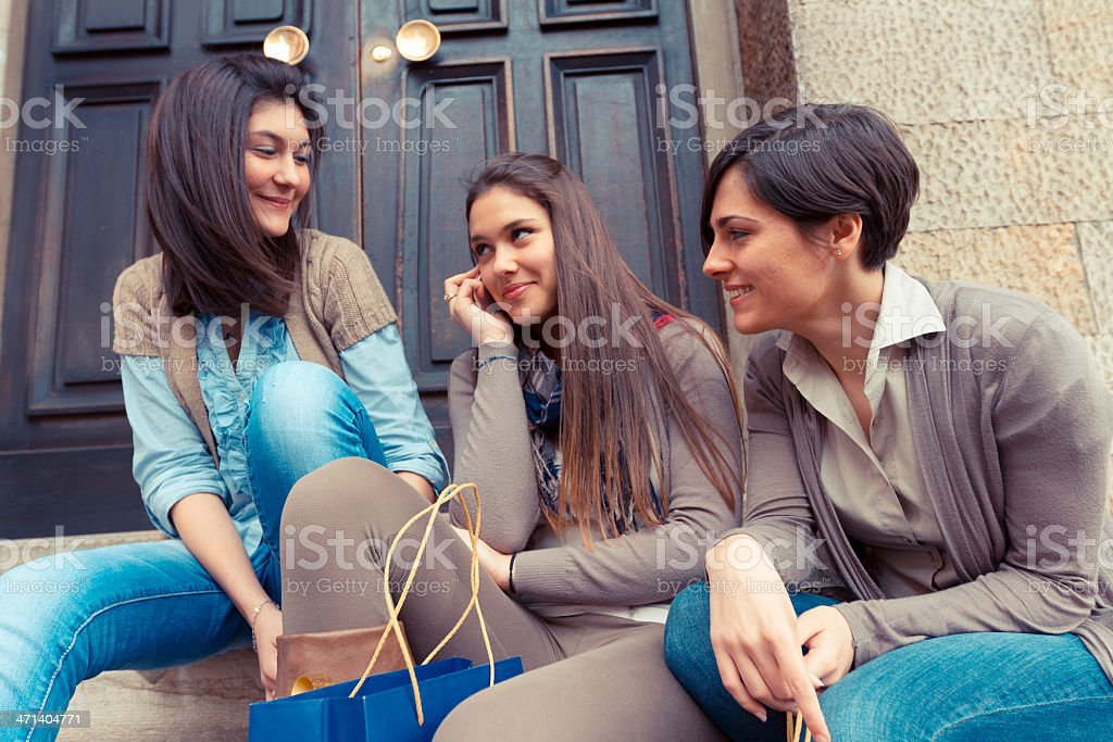Beautiful Young Women Chatting using Mobile Phone royalty-free stock photo