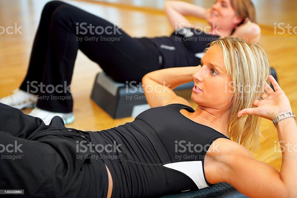 Beautiful young women exercising in a fitness center royalty-free stock photo