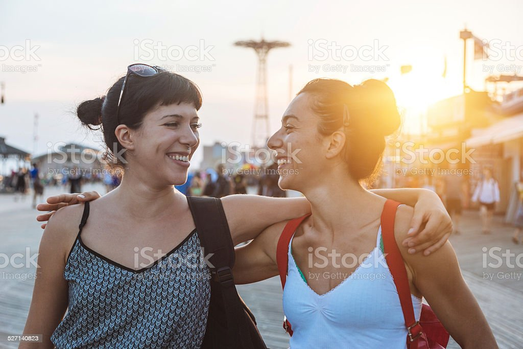 Beautiful Young Women in Coney Island at Sunset stock photo