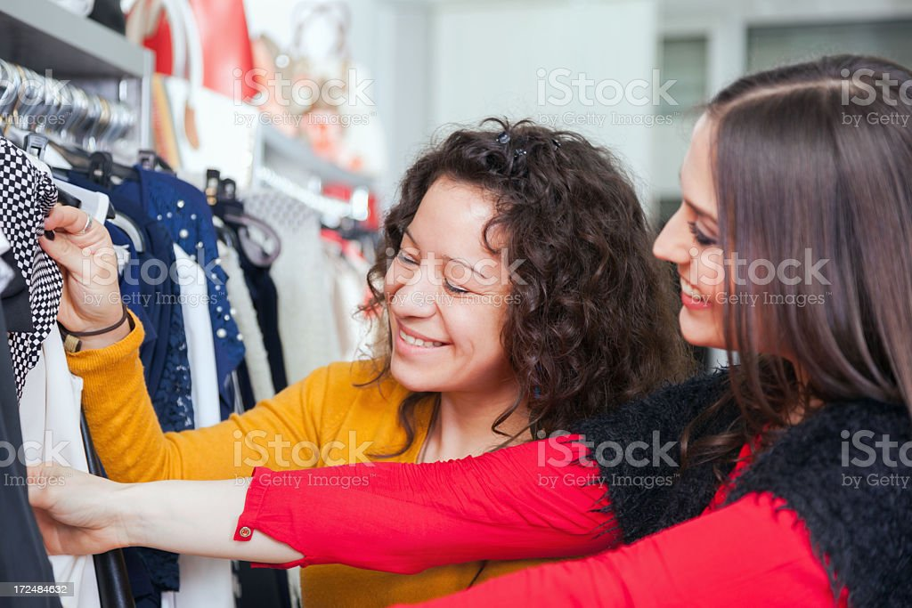 Beautiful young women shopping in a clothing store royalty-free stock photo