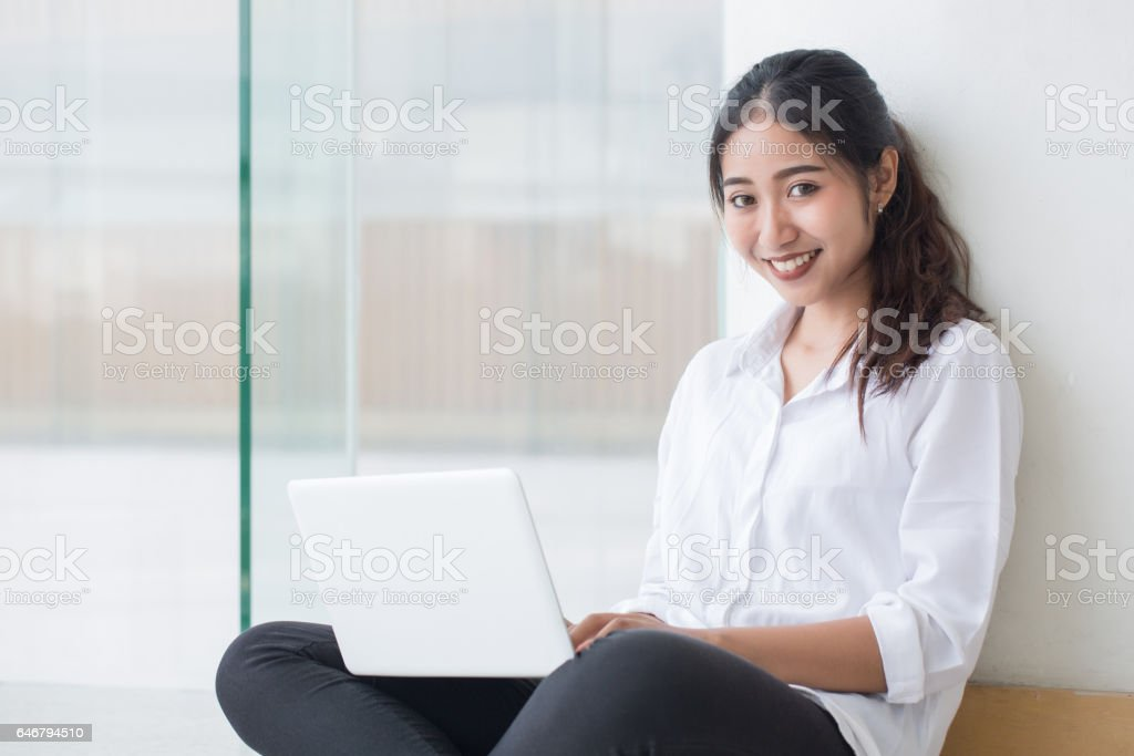 Beautiful young women with notebook tablet stock photo