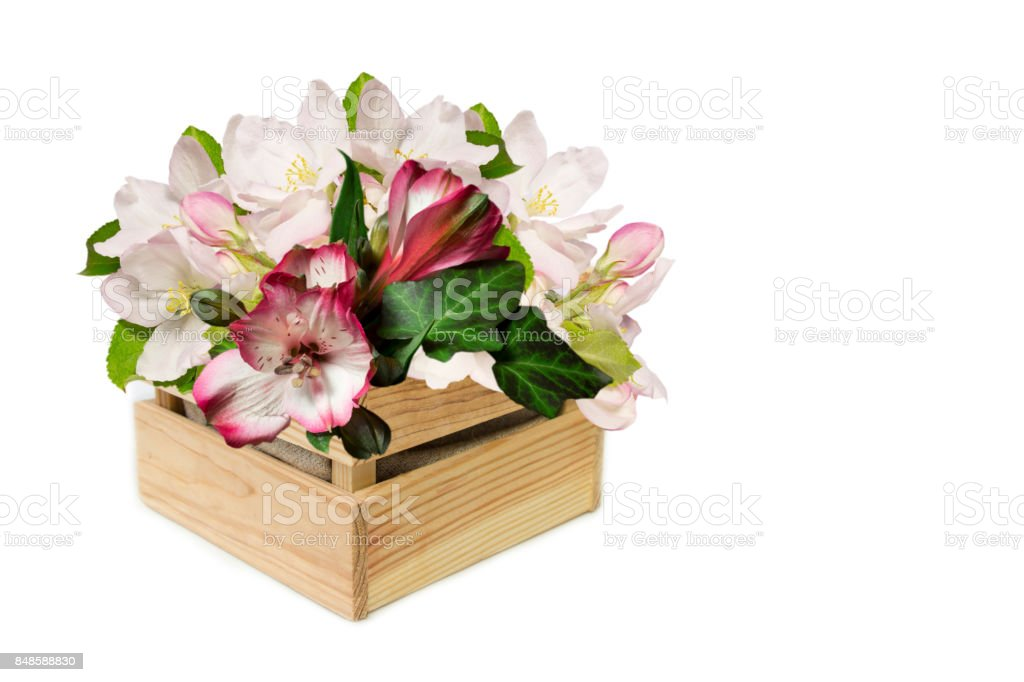 Beautifull bouqet in the wooden box(rhododendron  and apple tree flowers) stock photo