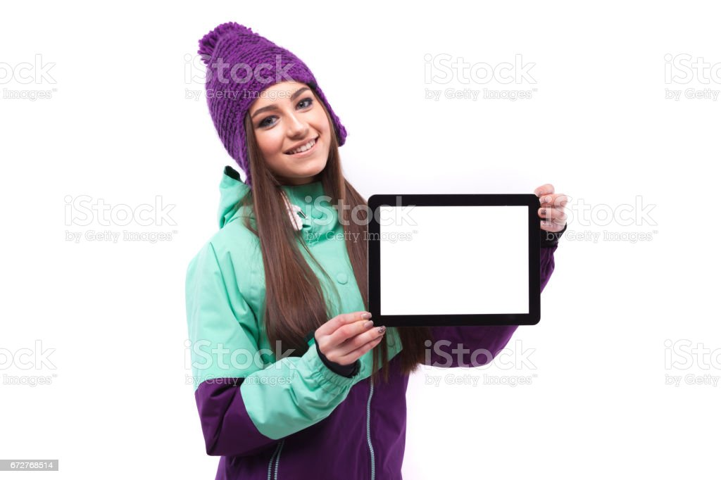 beautifull girl in ski suit with empty tablet stock photo