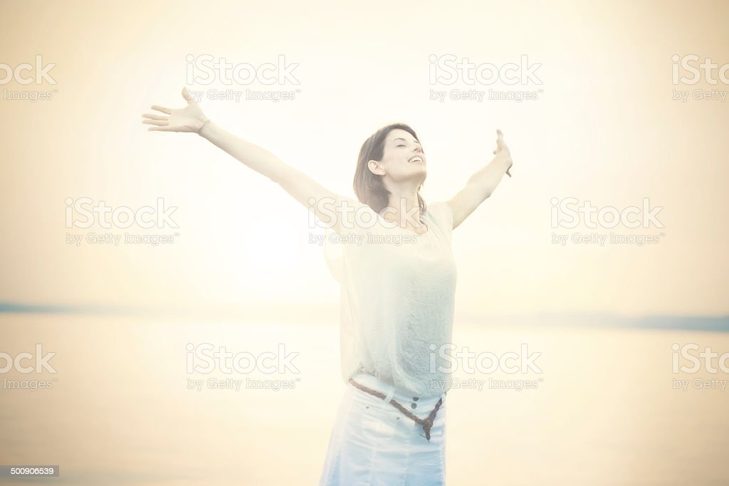 beautifull woman taking a deep breath at the sunset stock photo