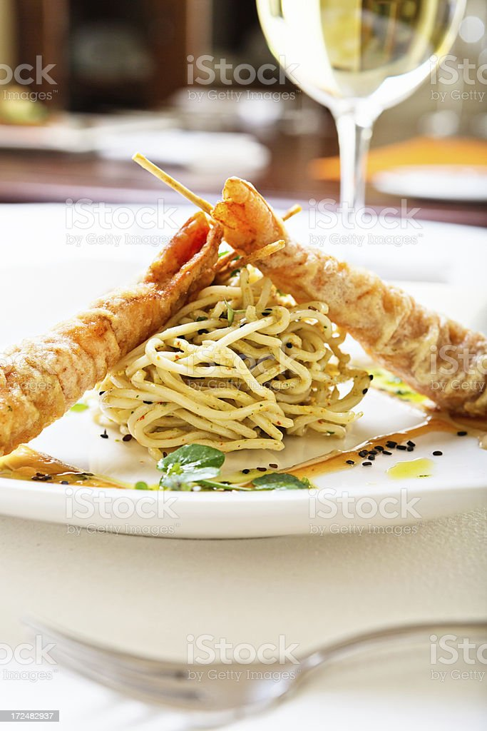Beautifully arranged tempura prawns, noodles and sesame sauce royalty-free stock photo