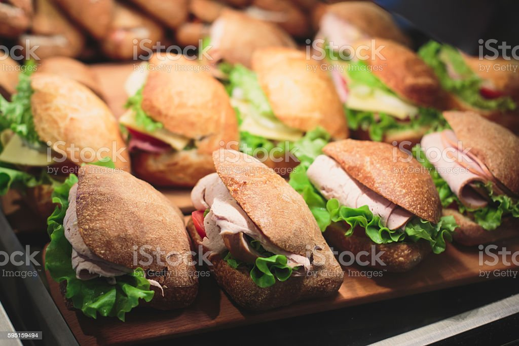 Beautifully decorated catering banquet table with sandwiches stock photo