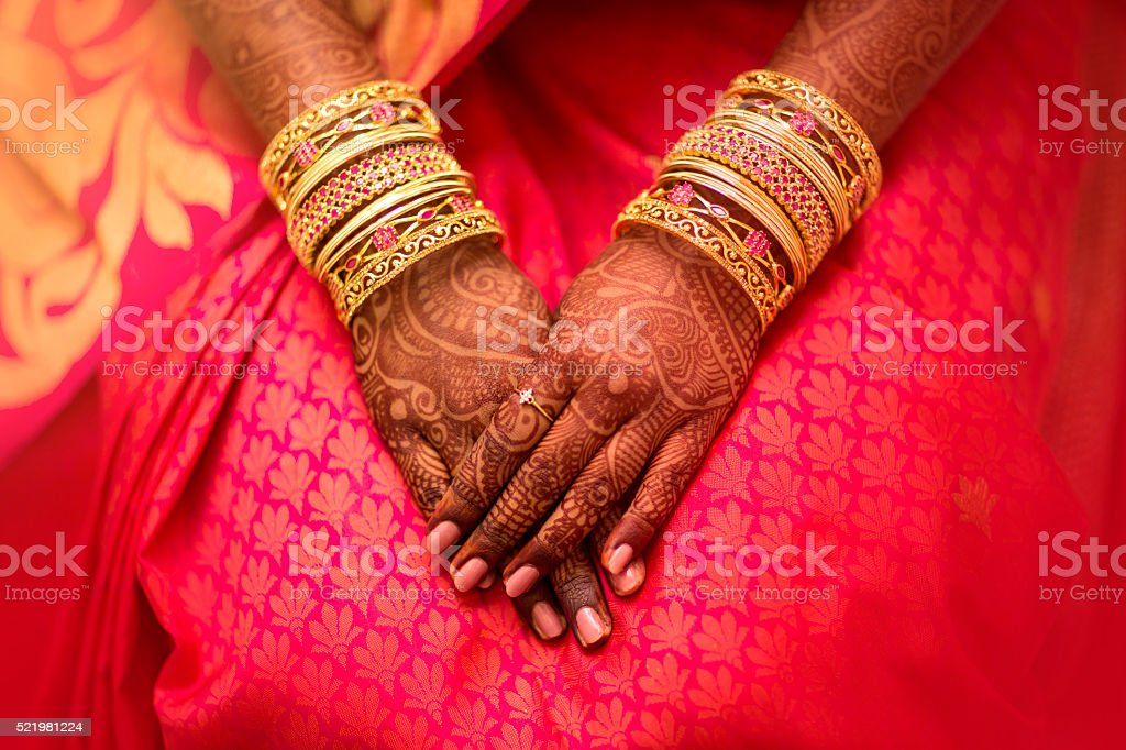 beautifully decorated Indian bride hands. stock photo