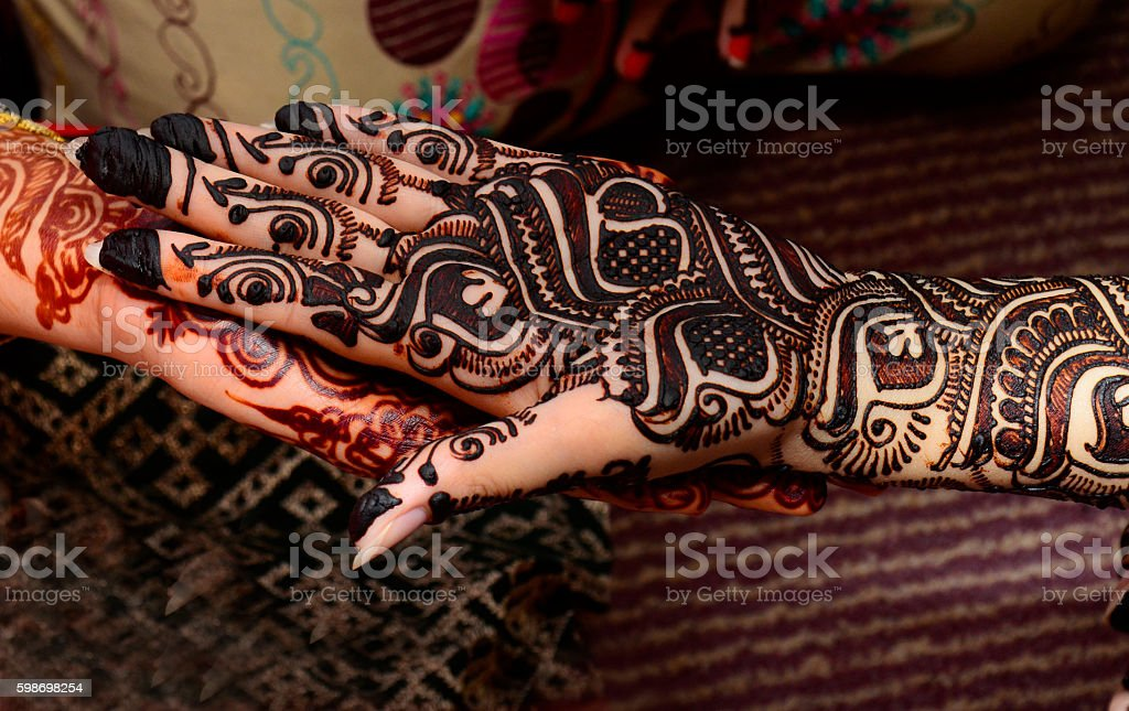 beautifully decorated indian hands with mehandi typically done for weddings stock photo