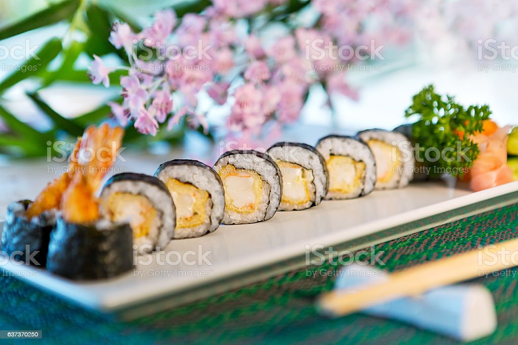 Beautifully decorated sushi on a plate. Sushi is the traditional stock photo