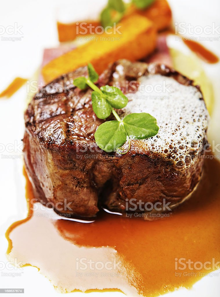 Beautifully garnished restaurant meal of grilled fillet steak stock photo