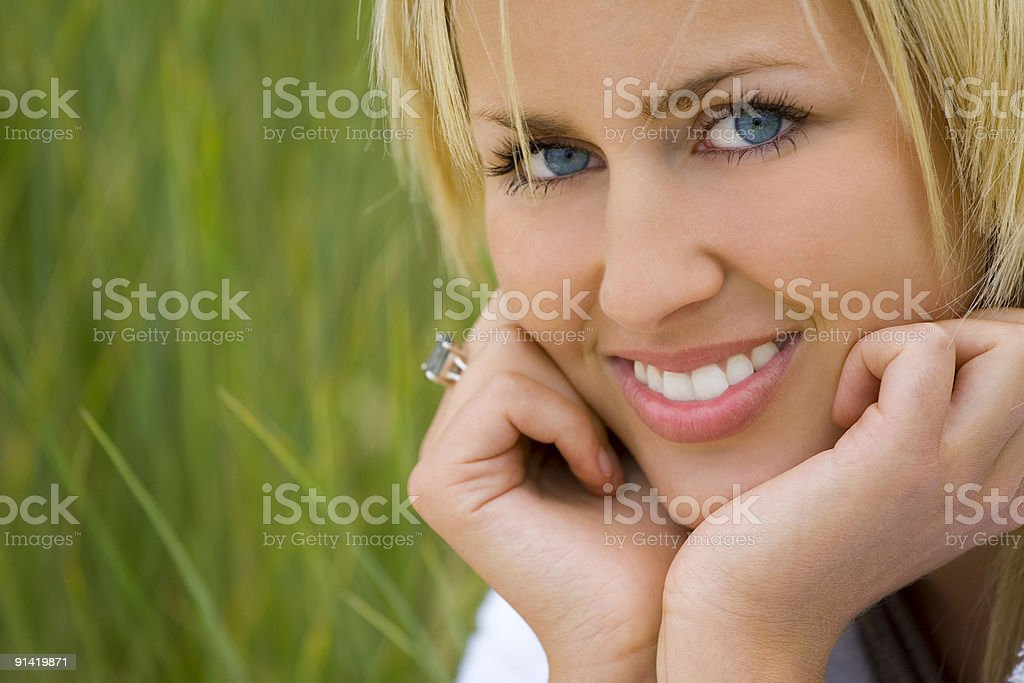Beautifully Happy Woman With Natural Green Grass Background royalty-free stock photo