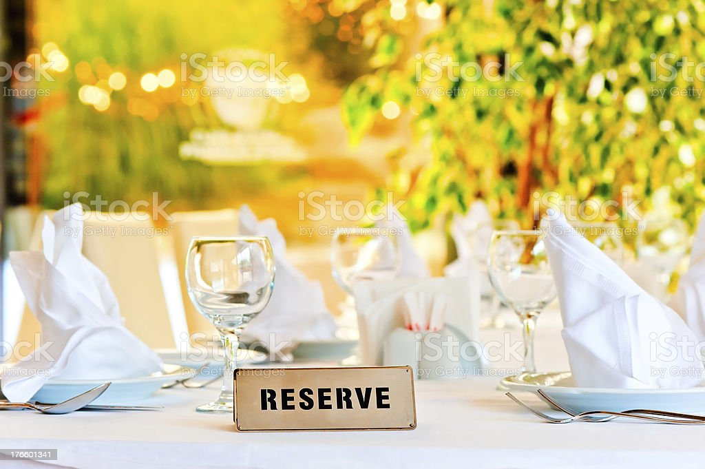 beautifully laid for supper table with a sign reserved stock photo